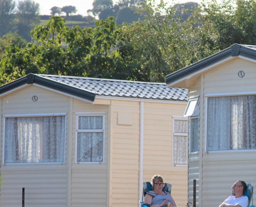 Guests sat outside holiday home